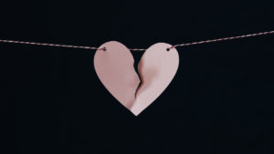 pink broken heart on string