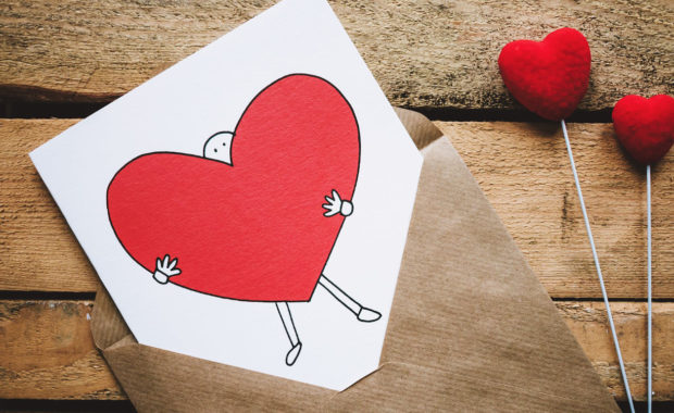 Love letter with a stick person holding a big heart