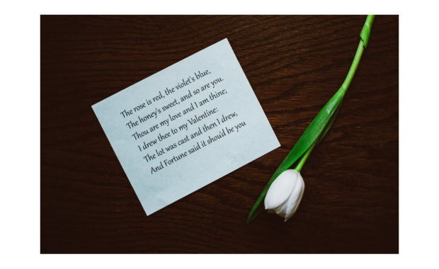 picture of paper with quote on it with a white tulip laying next to it