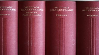 4 red books of Shakespeare's work in different languages